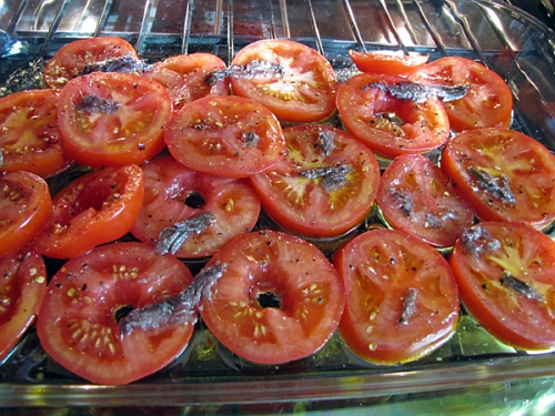 Roasting tomatoes and anchovies