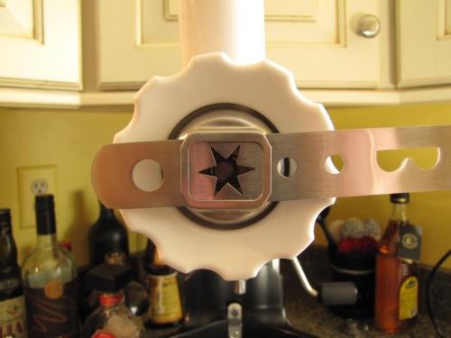 Star attachment on KitchenAid meat grinder.